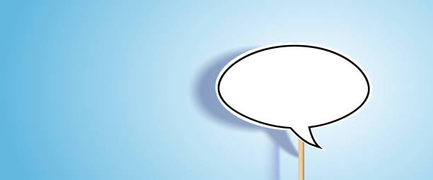 Blank chat bubble on blue background. stock photo