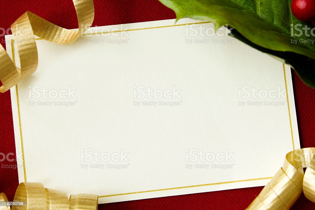 A blank Christmas card on a red background stock photo