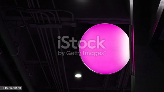 1140718043 istock photo Blank circle lightbox signage hang on wall 1197607579