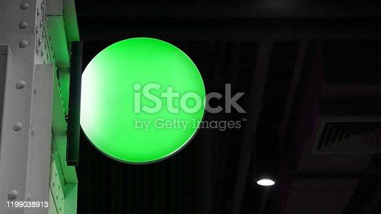 1140718043 istock photo Blank circle lightbox signage hang on wall 1199038913