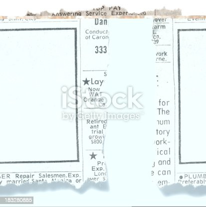istock Blank classified ad torn from newspaper on white background 183280885