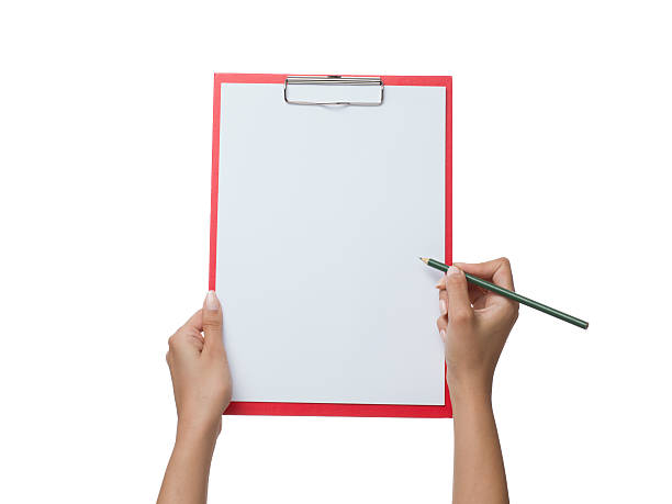 Blank clipboard in female human hand on white background stock photo