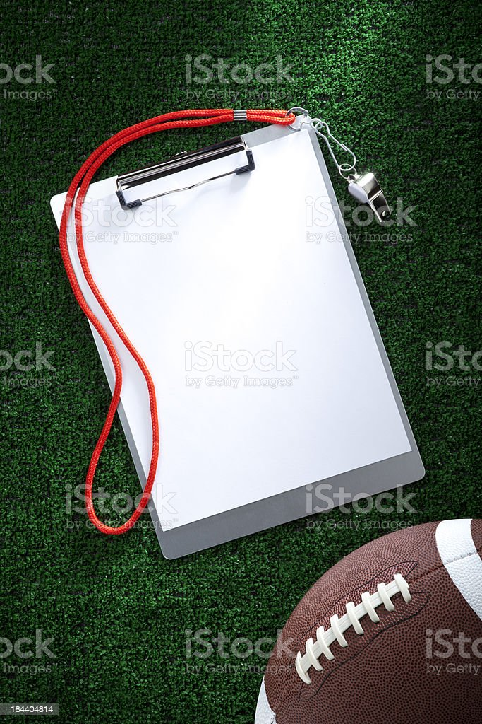 Blank Clipboard on AstroTurf with a Football stock photo