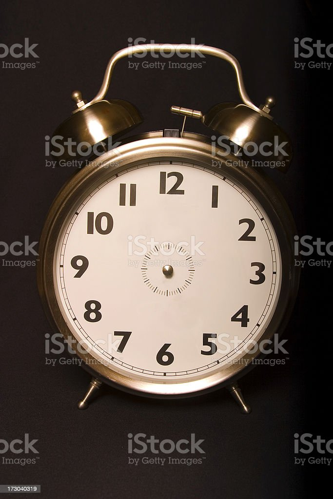 Old-fashioned iconic metal alarm clock face without hands. Add your...