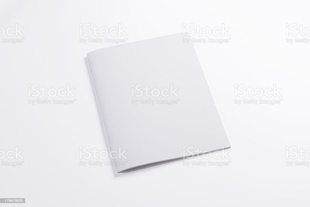 Blank closed magazine isolated on white stock photo