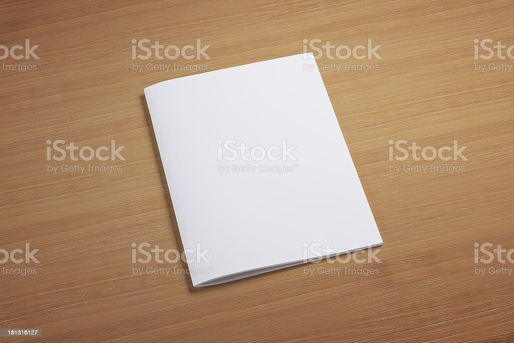 Blank closed magazine on wooden background stock photo