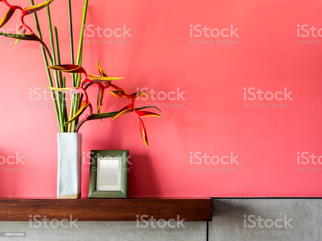 Blank colorful modern interior wall with flowers in ceramic vase royalty-free stock photo