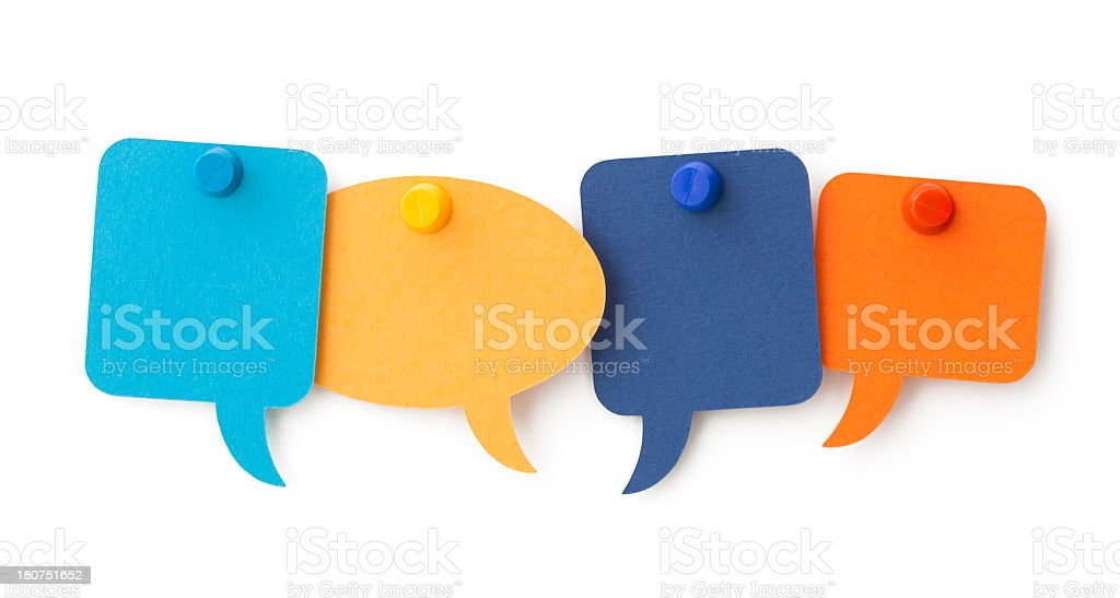 FOUR blank colourful speech bubbles pinned to a white surface stock photo