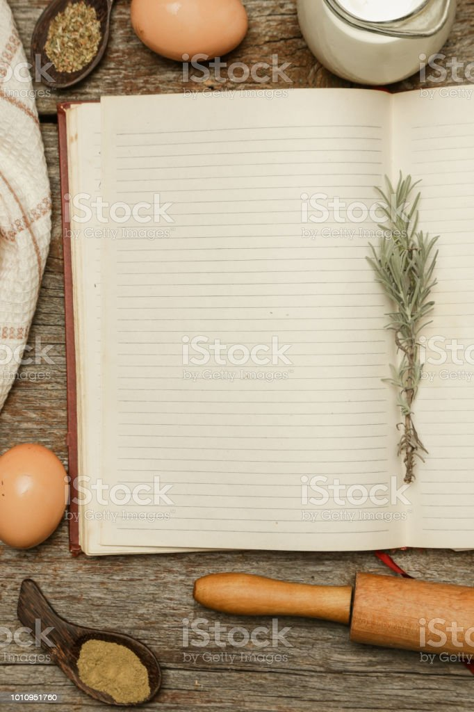 Blank cookbook with some ingredients on the wooden table, top view, rustic style stock photo