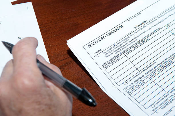 blank copy of beneficiary change form being read - beneficiary stock pictures, royalty-free photos & images