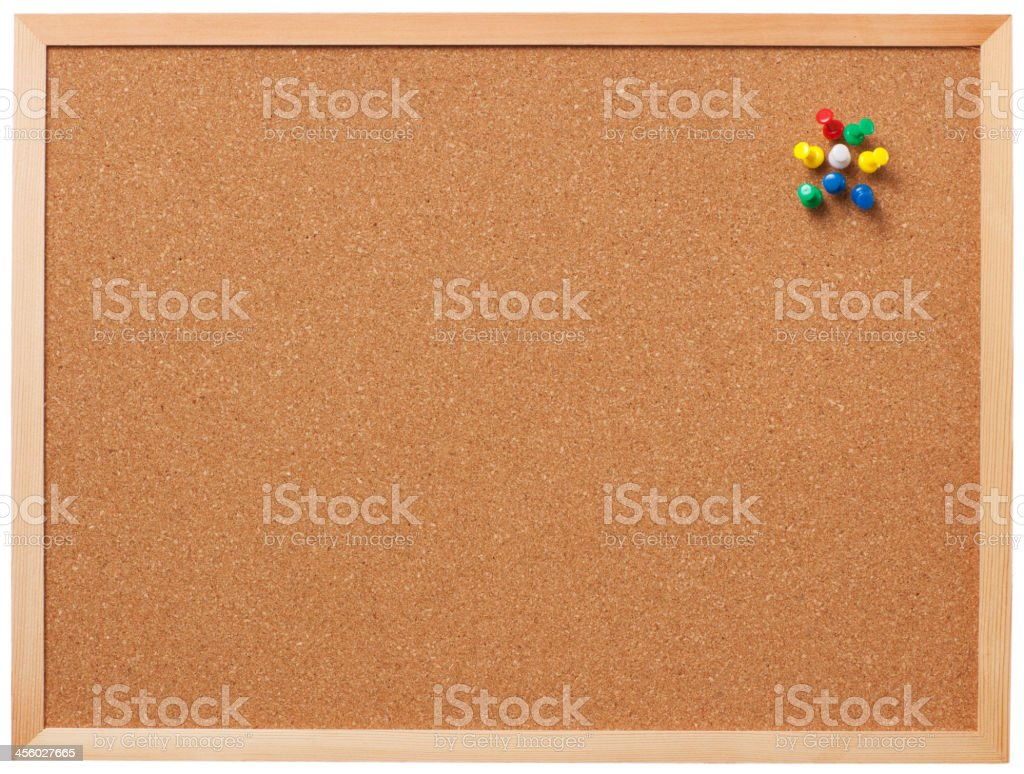 Blank cork board with pins. stock photo