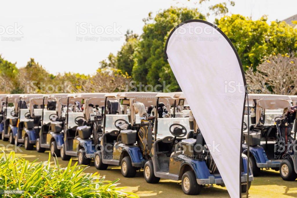 Blank Corporate Banner And Golf Carts zbiór zdjęć royalty-free