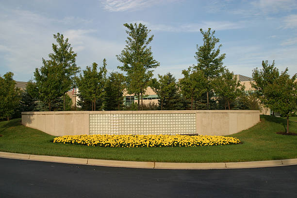 Blank Corporate Sign with Flowers, Landscaping stock photo