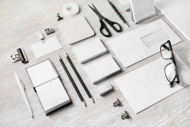 Blank corporate stationery Blank corporate stationery set on light wood table background. Branding mock up. Template for placing your design. office equipment stock pictures, royalty-free photos & images