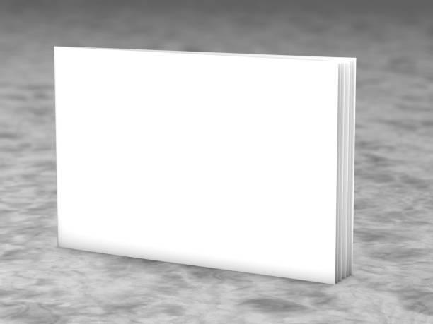 Blank cover horizontal landscape orientation brochure standing on marble floor. stock photo