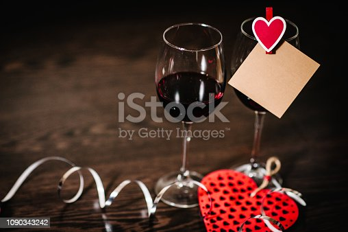 istock Blank, craft paper, red heart, wine on brown wooden background with space. Place for text. concept Women's Day, eighth of March. Wedding, jubilee. Love. 1090343242