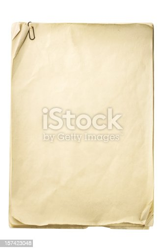 Stack of old papers with paper clip isolated on white