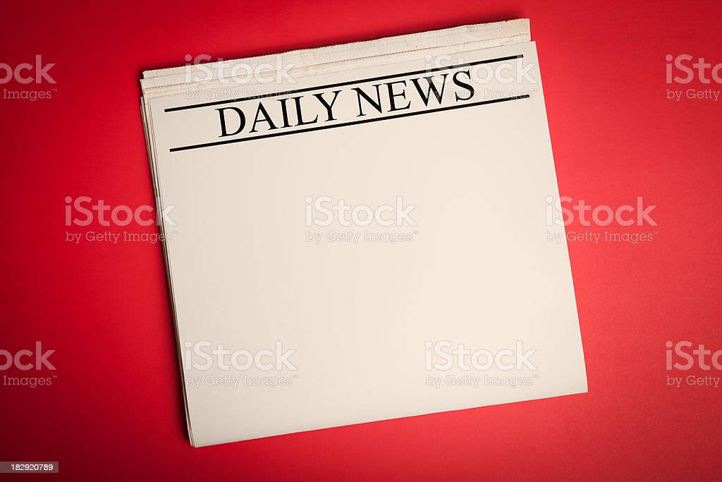 Blank Daily Newspaper on Red Background for Your Announcement royalty-free stock photo