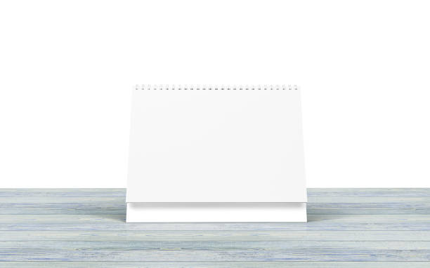 Blank desk calendar on wooden desk isolated on white. Blank desk calendar on wooden desk isolated on white. almanac stock pictures, royalty-free photos & images