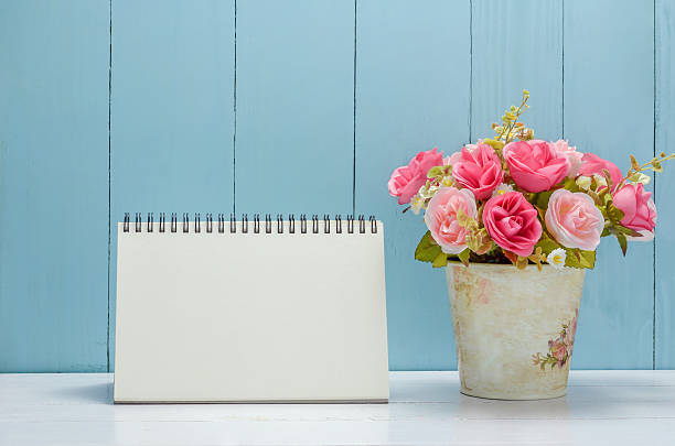 Blank desk calender with pastel rose flowers stock photo