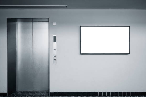 Blank digital LCD screen on wall Indoor Building with elevator Blank Mock up digital LCD screen on wall Indoor Building with elevator liquid crystal display stock pictures, royalty-free photos & images