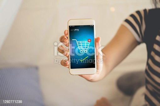 Blank display smartphone on shopping store online display text pay and shopping cart on screen