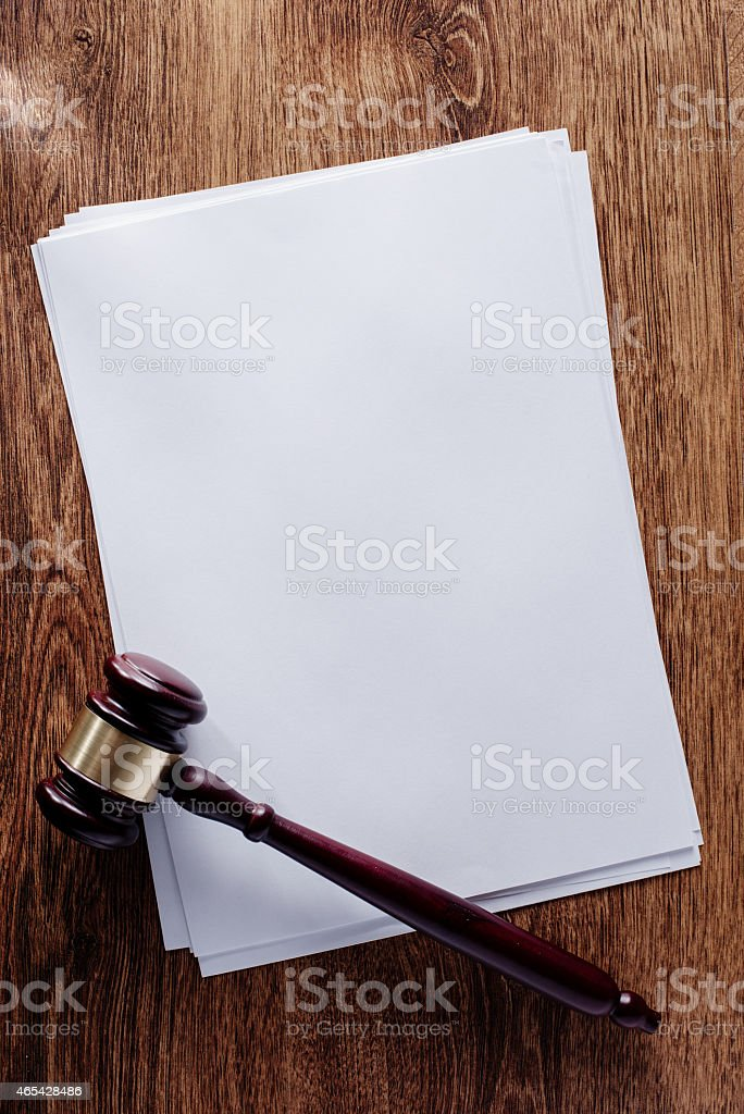 Blank Documents and Gavel on Wooden Table stock photo