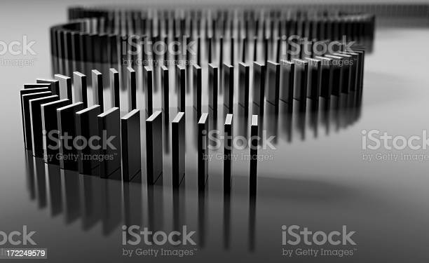 Blank Domino Pieces Set Up To Fall Over In A Chain Reaction Stock Photo - Download Image Now