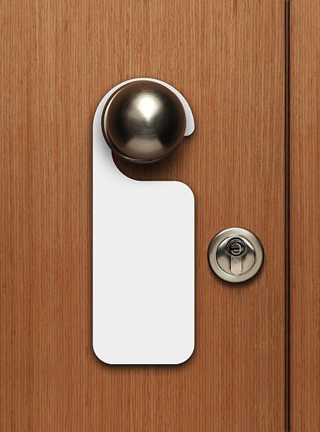 Blank door sign hanging from knob stock photo