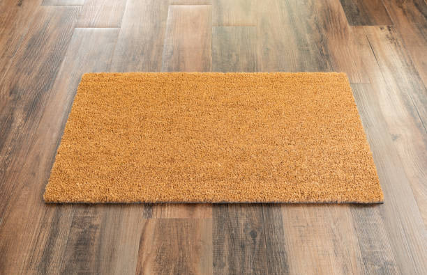 Blank Doormat On Wood Floor Background Ready For Your Own Text stock photo