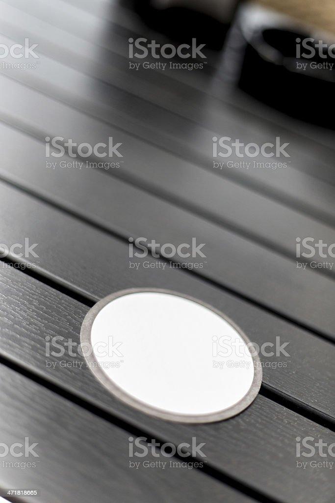 Blank Drinks Coaster on Black Wooden Table stock photo