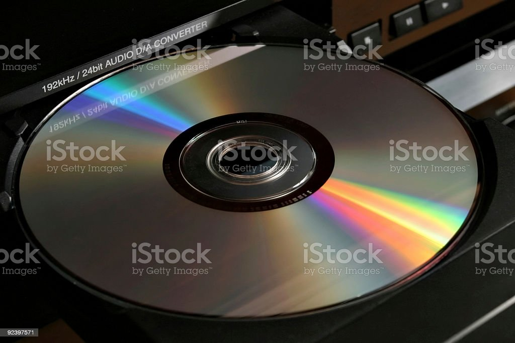 A blank DVD resting on the tray of a DVD player stock photo