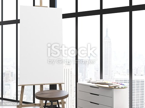 1021586250istockphoto Blank easel in interior 576892054