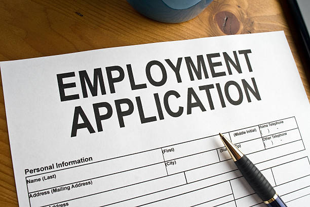 Blank employment application ready to be filled out Blank Employment Application on a desktop application form stock pictures, royalty-free photos & images