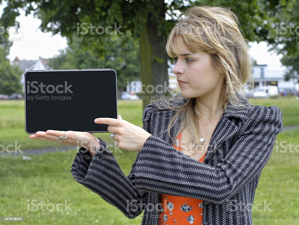 English outdoor girl holding blank tablet royalty-free stock photo