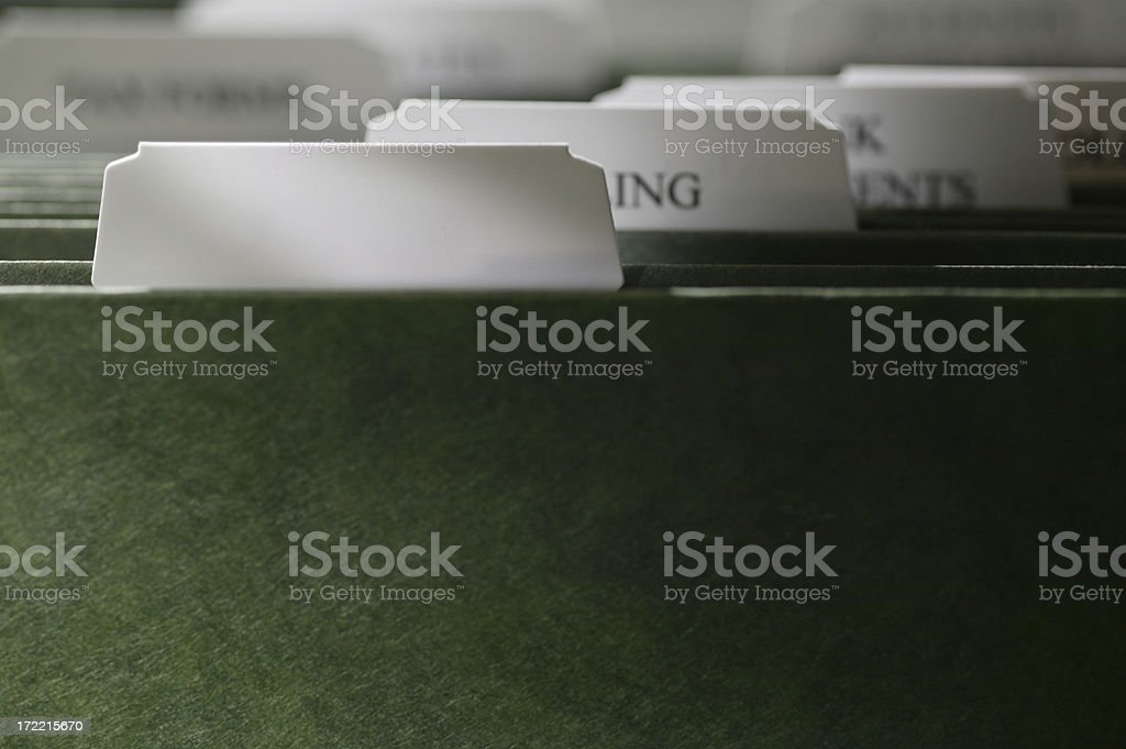 Blank File Tab On Folder In A File Cabinet royalty-free stock photo
