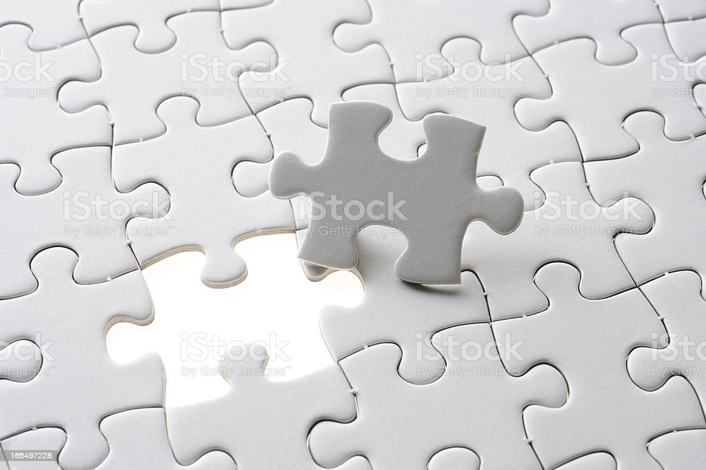 Blank final piece of the jigsaw with light from behind royalty-free stock photo