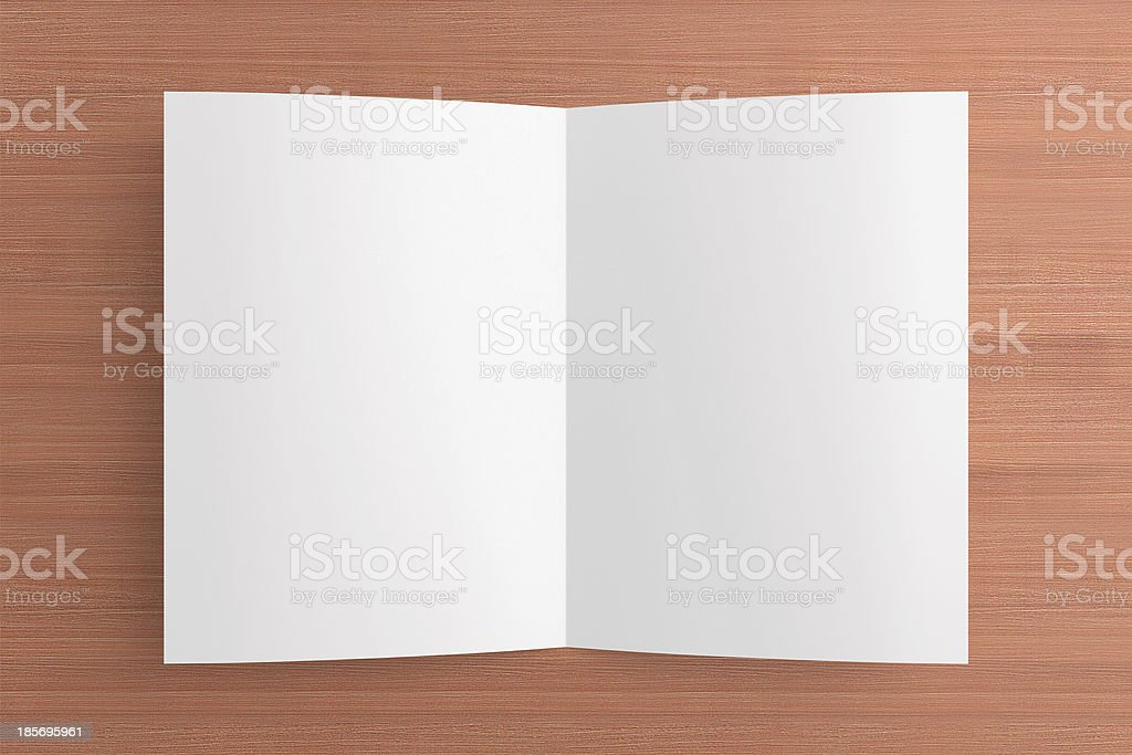 Blank folded card on wooden background royalty-free stock photo