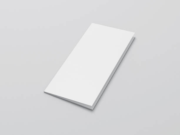 Blank folded paper Leaflet or Flyer mock up on gray background stock photo