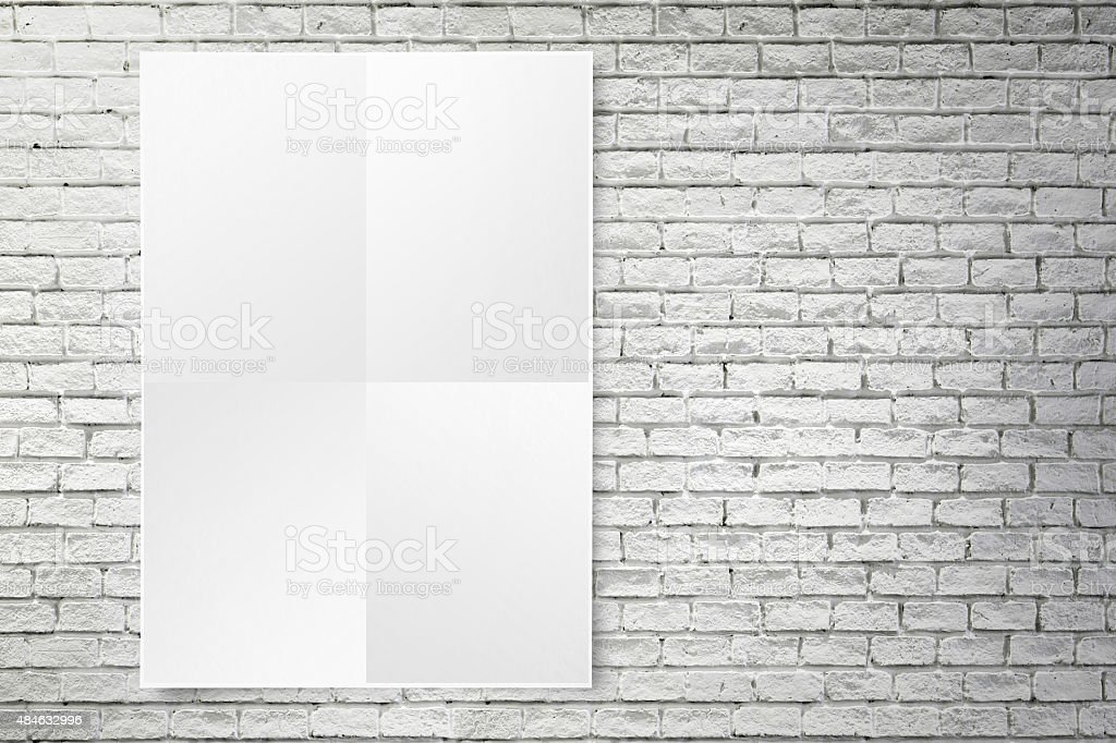 Blank Folded Paper Poster Hanging On White Brick Wall Stock Photo ...