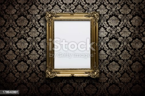 Ornate gold frame at grunge wallpaper with clipping path for the inside