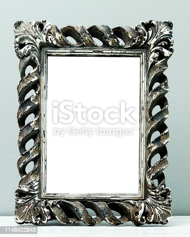 532332971 istock photo Blank frame on a gray background 1148422843