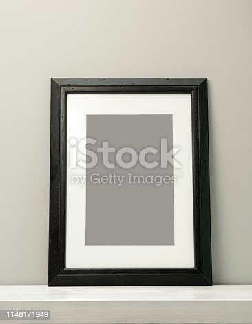532332971 istock photo Blank frame on a gray background with clipping path 1148171949