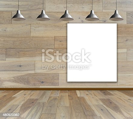 istock Blank frame on wood wall with Ceiling lamp 480920362