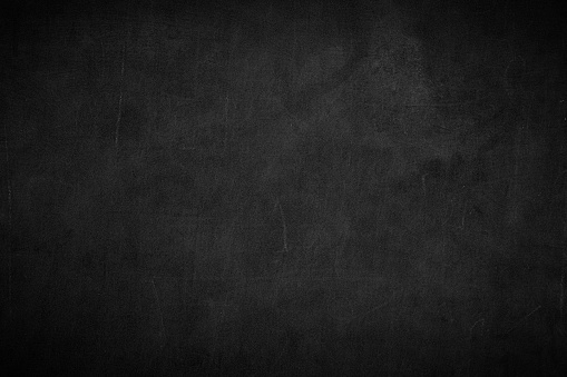 Blank front Real black chalkboard background texture in college concept for back to school kid wallpaper for create white chalk text draw graphic. Empty old back wall education blackboard.