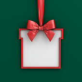 istock Blank gift box frame banner template hanging with shiny red ribbon and bow isolated on green background with shadow for christmas decoration 3D rendering 1076812332