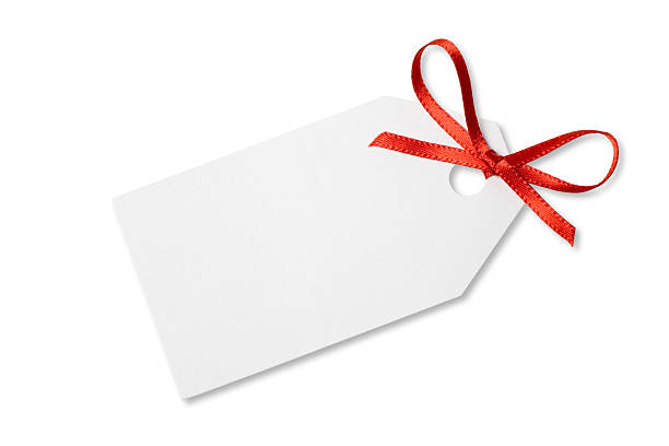 Blank Gift  or Price Tag on White with Clipping Path A blank gift tag tied with red ribbon on a white background.  Clipping Path included. label stock pictures, royalty-free photos & images