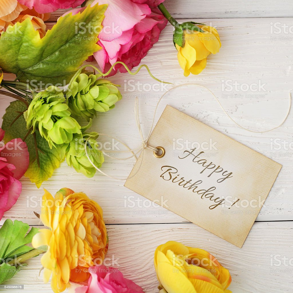 blank gift tag and flowers stock photo