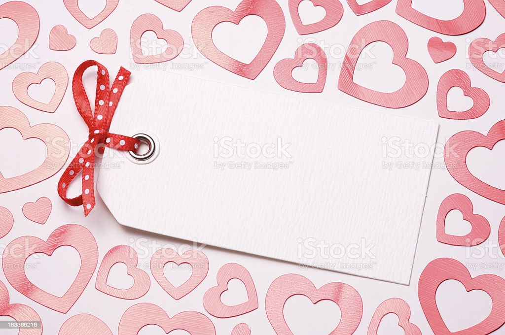 Blank Gift Tag Surrounded by Shiny Hearts stock photo