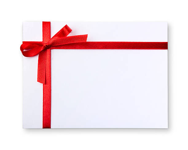 Blank gift tag tied with a bow of red ribbon stock photo